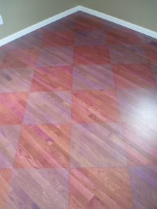 Stain checker board hardwood floor